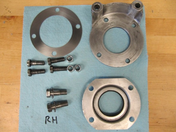 RH Oil Seal Assembly Components and Caliper Adaptor After